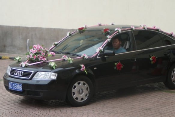 A Chinese wedding car decorated with flowers
