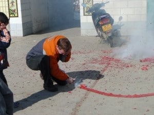 Firecrackers being set off during a Chinese wedding in Xinjiang