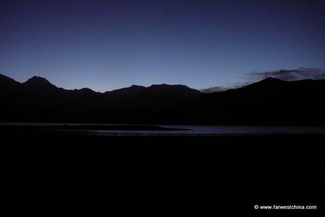 The sun rising over Karakul Lake in Xinjiang, China