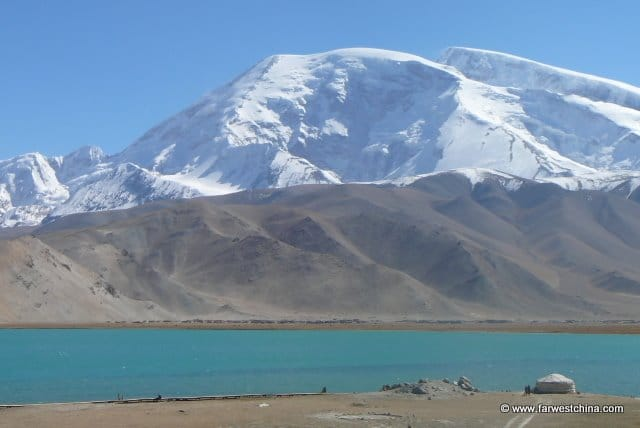 The Muztag Ata presides over Karakul Lake in Xinjiang
