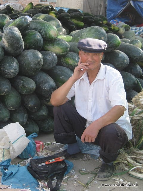 A Uyghur man selling watermelon in Xinjiang