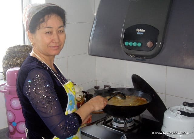 A Uyghur woman cooking at home