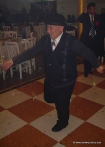 An old man doing a Uyghur dance at a wedding