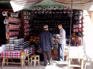 A man selling Uyghur hats in Kashgar