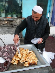 A Uyghur Man Serves Samsa