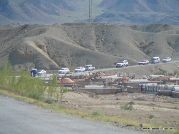 A funeral procesion headed to a Xinjiang cemetery