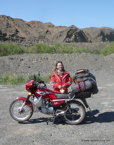 Motorcycle loaded for a road trip in Xinjiang, China