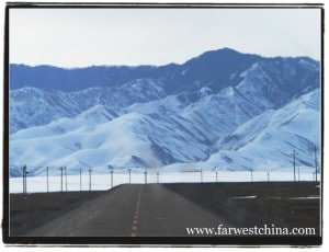 A beautiful Xinjiang highway with a mountain backdrop