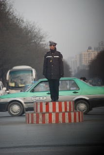 A Chinese policeman directs traffic