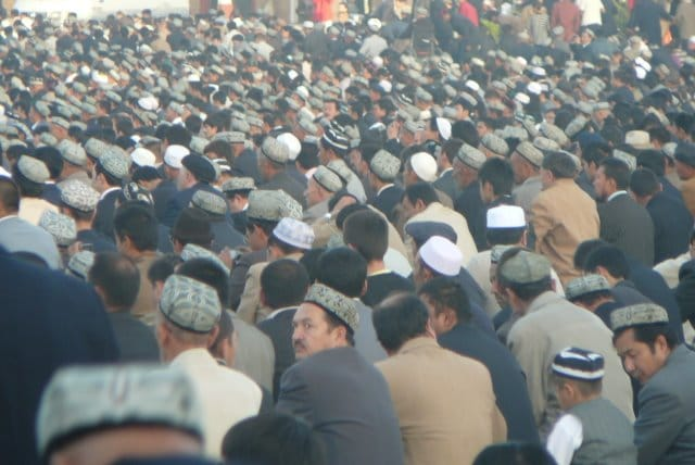 Muslim Uyghur pray on the last day of Ramadan
