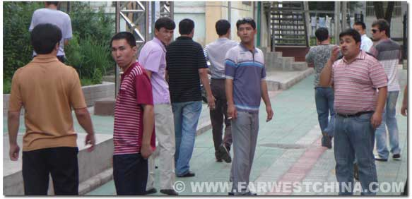 Uyghur men exiting the housing community