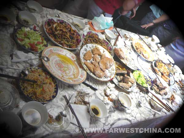 A Uyghur table full of empty plates after a meal
