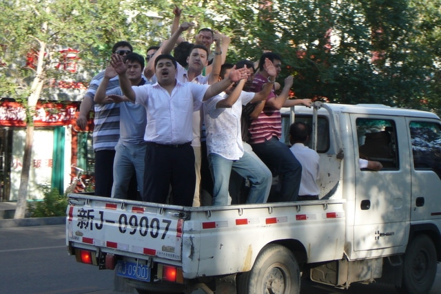 A truck full of Uyghur men celebrating a wedding via the parade