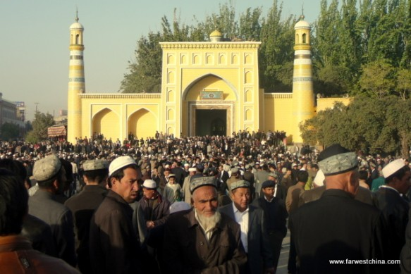Uyghur men exit Kashgar's Id Kah mosque after prayers
