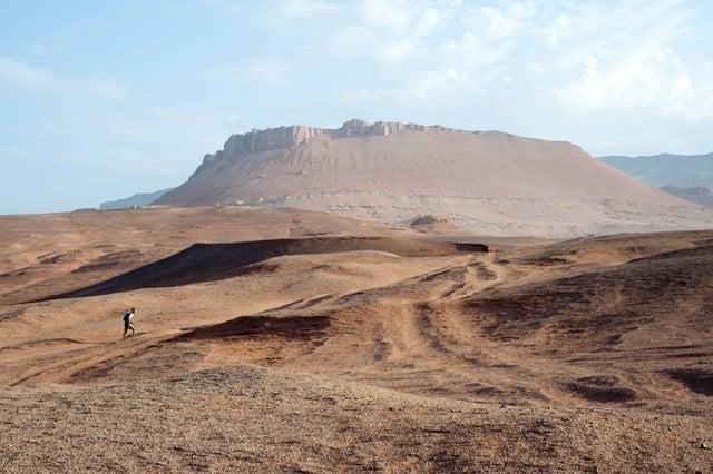 A single competitor races through the Gobi Desert