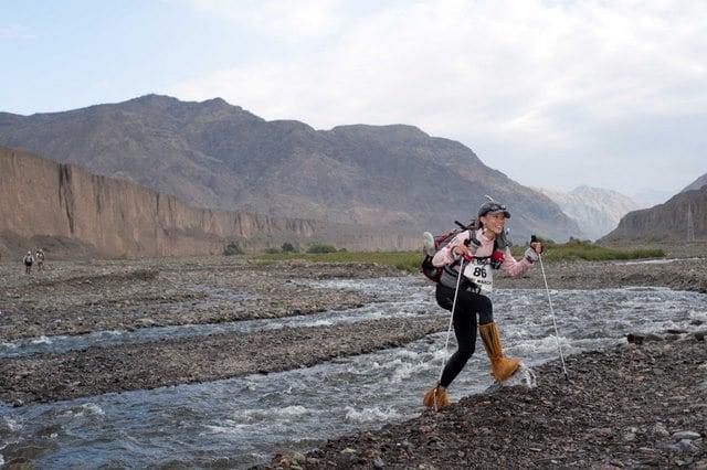 Gobi March women's winner Denvy Lo crosses a stream