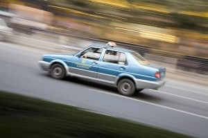 A China taxi speeds by