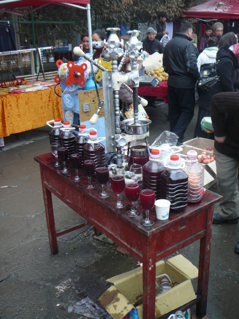A cart filled with glasses of pomegranate juice in Xinjiang, China