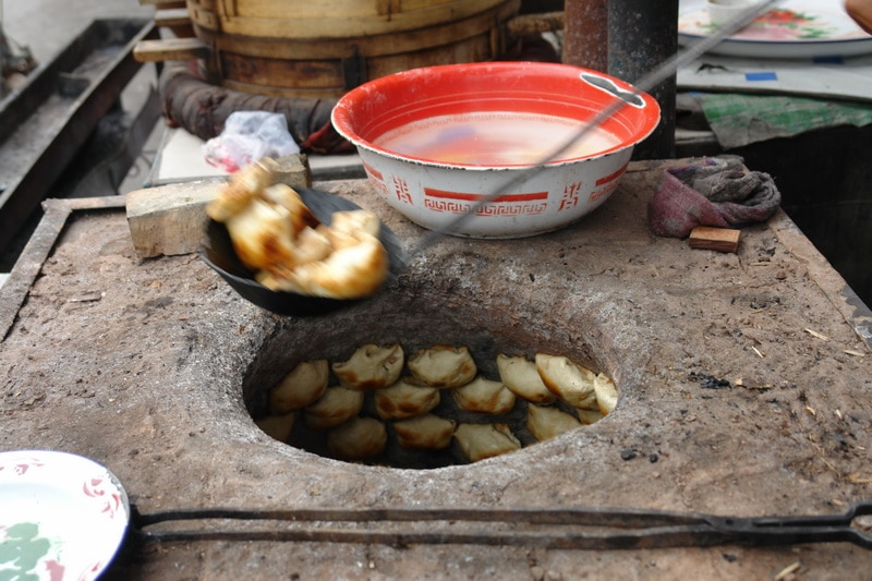Samsa cooking in a Uyghur oven in Xinjiang, China