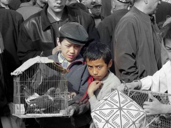 Two Uyghur boys at a Xinjiang market in Kashgar