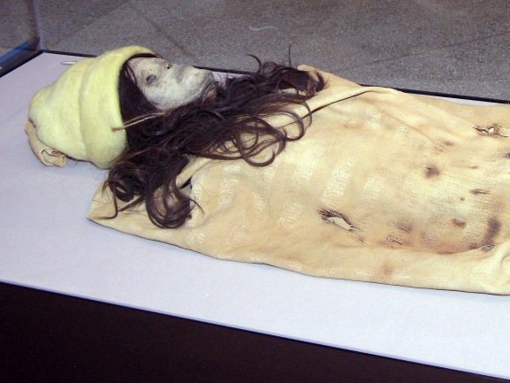A paper mache mummy in place of the Xinjiang mummy