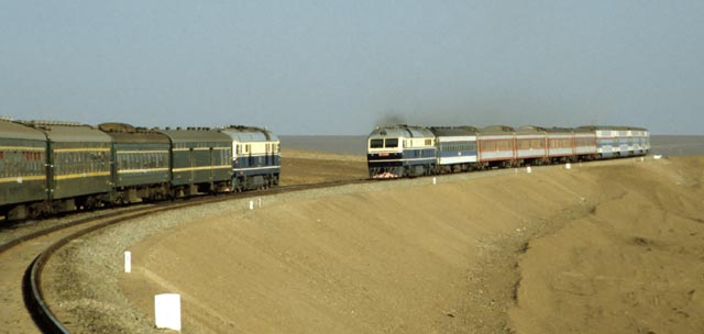 A train traveling along the Xinjiang desert