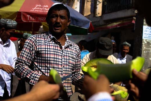 A seller of Hami melons in Xinjiang's Silk Road oasis of Kashgar