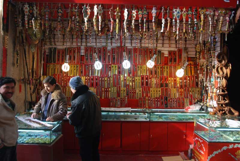 A Uyghur knife seller in Urumqi, Xinjiang