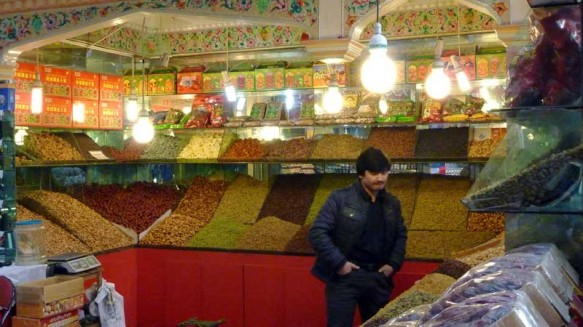 A fruit and nut seller in Urumqi, Xinjiang