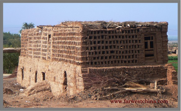 A Uyghur mud-brick building to dry grapes in Tuyoq near Turpan