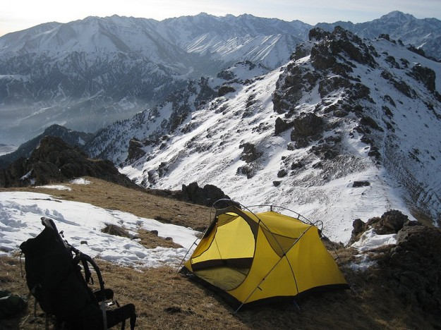 Setting up tent in the Xinjiang Tian Shan (China)