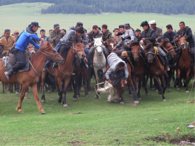 The game of Buzkashi begins as the goat carcass is retreived