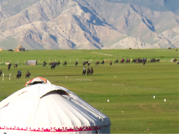 A game of Buzkashi as seen from a distance in Xinjiang