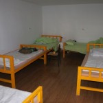 A 5-bed dorm room at the Turpan White Camel Youth Hostel