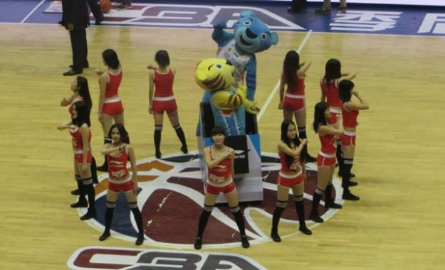 Dancers and mascots dance during a CBA game in Urumqi, Xinjiang