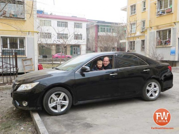 Me and my son in our rented Toyota Camry