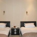 A twin room at the Turpan Silk Road Lodge - The Vines in Xinjiang
