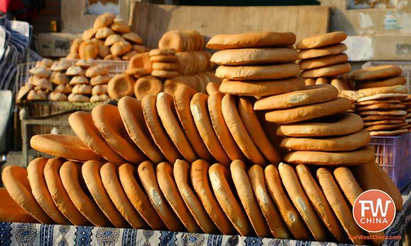 Uyghur bread stacked along a Turpan street in Xinjiang