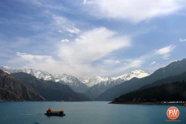 A beautiful view of Xinjiang's Heavenly Lake with a boat