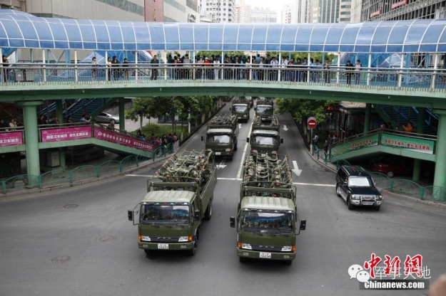A parade of troops and tanks in Urumqi, Xinjiang on May 24, 2014