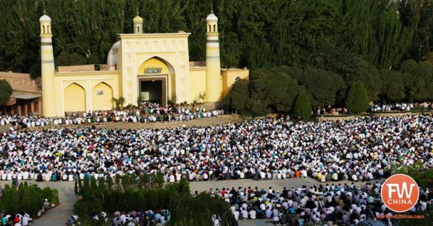 Thousands of Uyghur pray at the Id Kah Mosque in Xinjiang, China