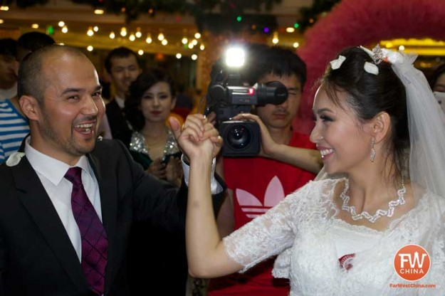 A happy Uyghur bride and groom during their Uyghur wedding in Urumqi, Xinjiang