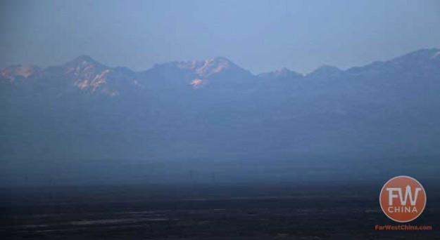 The mountain view outside the Xinjiang train window