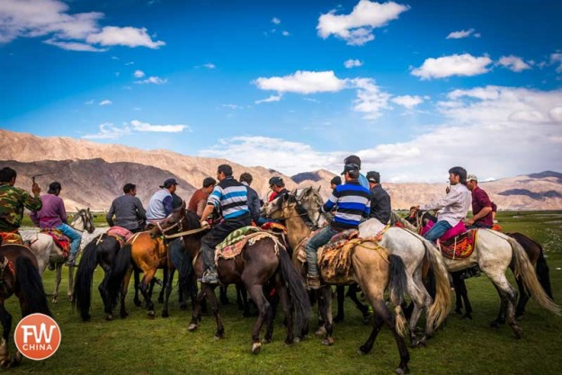 A scrum of Buzkashi Tajik players in Tashkurgan, Xinjiang