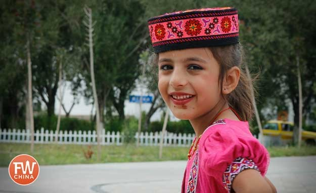 Young Tajik girl dressed up in Tashkorgan, Xinjiang