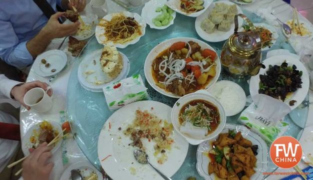 A table full of food at a Uyghur wedding in Urumqi, Xinjiang