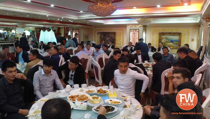 Uyghur men all sitting together at a Uyghur wedding in Urumqi, Xinjiang
