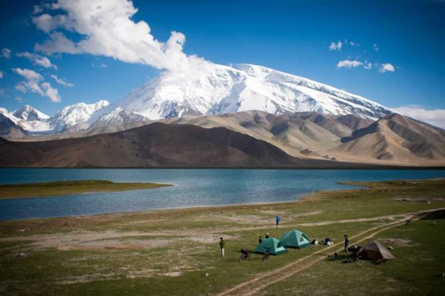Tent camping in Xinjiang next to Karakul Lake