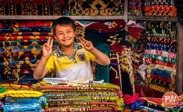 Uyghur boy smiles for the camera in Kashgar, Xinjiang