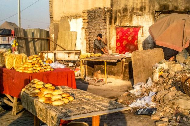 Uyghur bread seller in Kashgar, Xinjiang